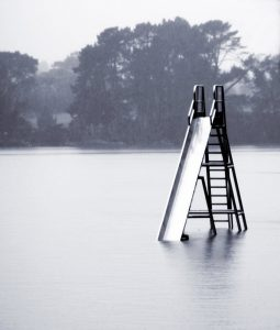 flooded slide showing the need for artificial sports surfaces