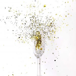 Confetti coming out of a glass, signifying the celebratory mood after successful CIF bid applications.