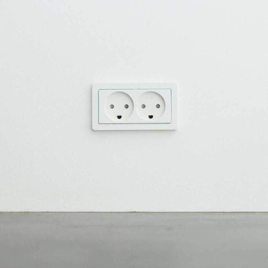 A plug socket to represent electrical building surveying.