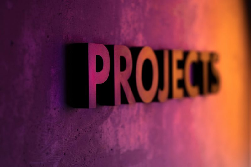 A wall reading 'projects' to represent project management.