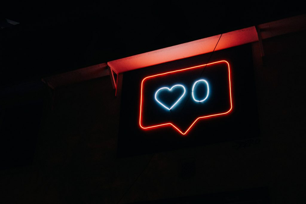 An image of a neon sign 'like' button to represent social media and how it's changed architectural design.