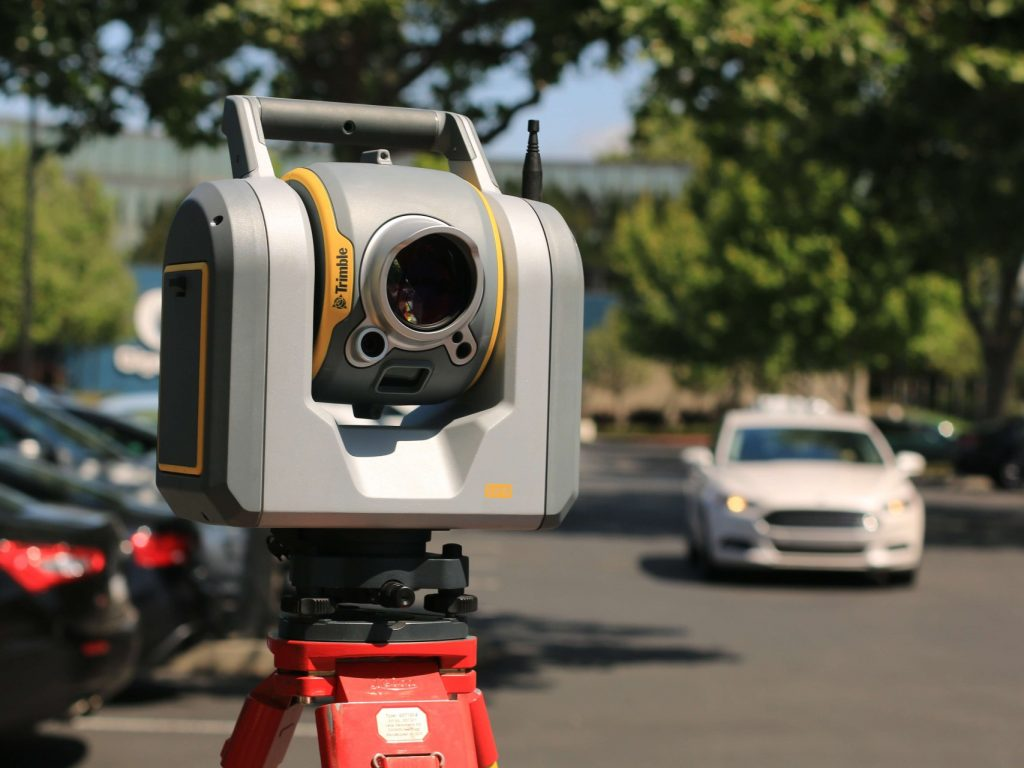 An image of a theodolite to represent geospatial surveying work.