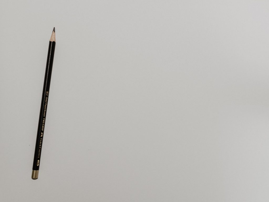 A pencil on paper to represent architecture and design.